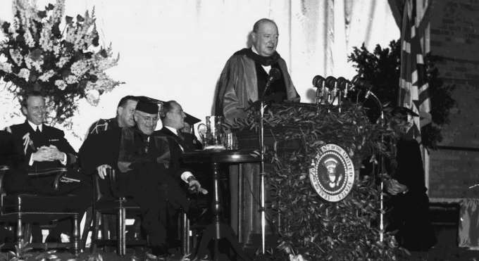 "Delivers his ""Iron Curtain"" speech at Westminster College, Fulton, MO"